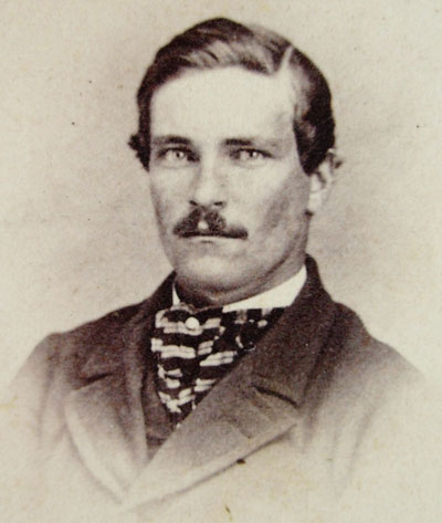 Neck scarf wearing mustached gentleman of the 1860s-1870s.