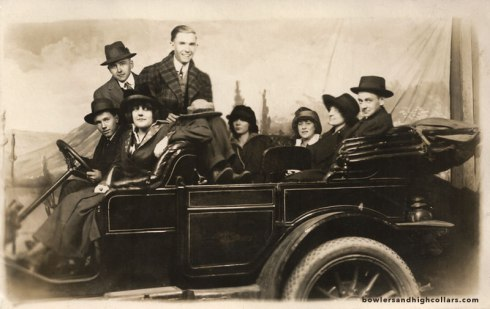Studio photo of group in a car. RPPC. Private Collection.