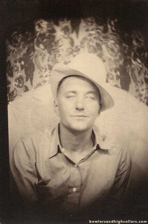 Photobooth picture of man in white hat.
