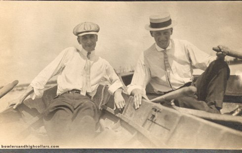 Two gents on rowboats. RPPC. Private Collection.
