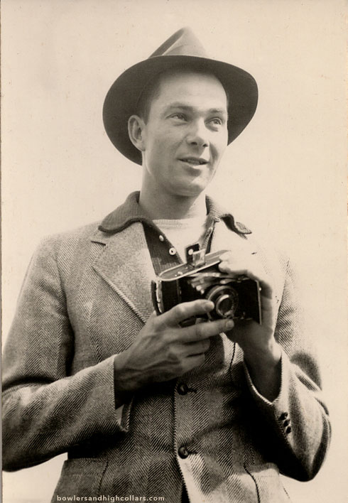 The late 1940s smiling photographer in fedora  5d89c883b2d