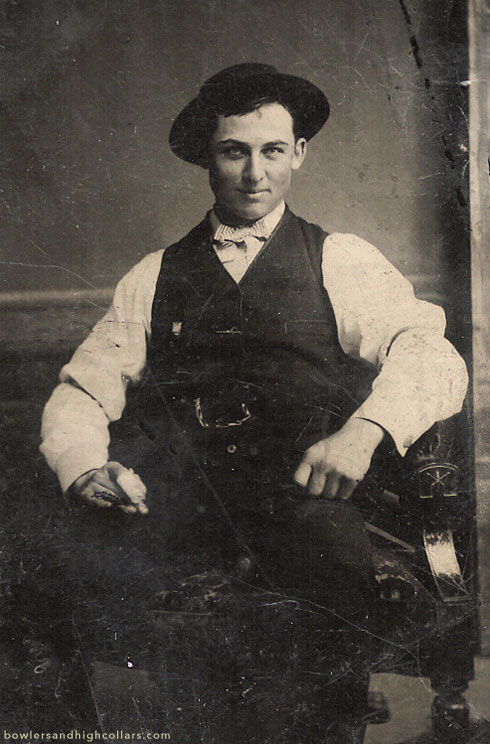 Smiling impishly with a bandaged finger. Tintype. Private Collection.