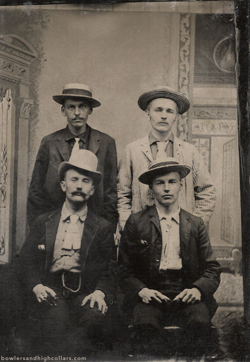Three brothers and their other. Tintype. Private Collection.