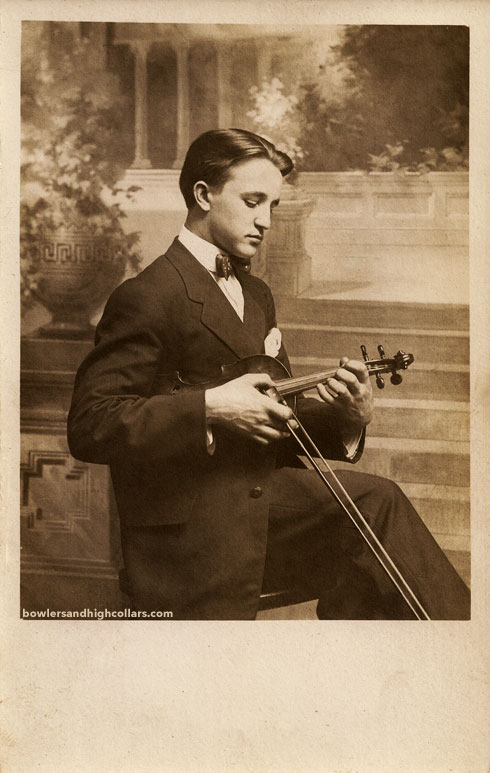 Joe Lucas playing pizzicato. RPPC. Private Collection.