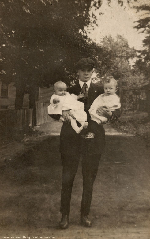 Father and two babies. 1910s. RPPC. Private Collection.