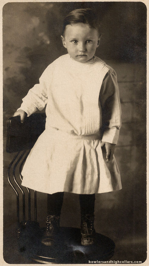 Toddler in white dress. RPPC. Private Collection.