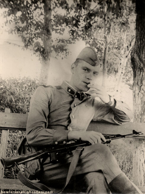 1940s soldier with rifle. Snapshot. Private Collection.