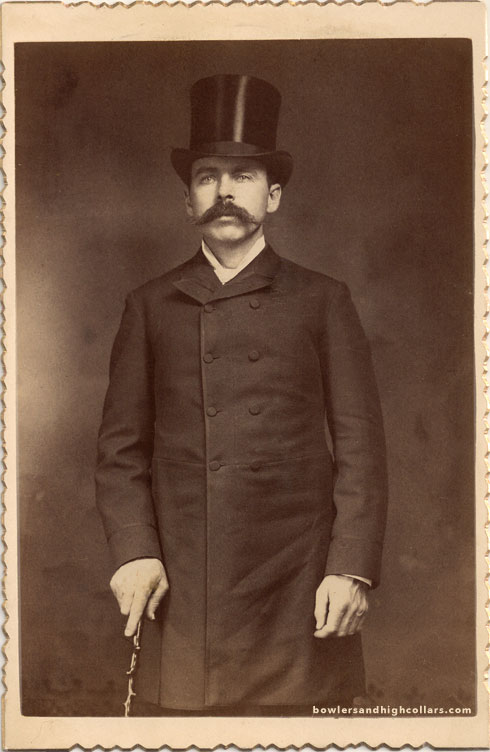 Victorian gentleman with cane, top hat and mustache. Cabinet card. Private Collection.