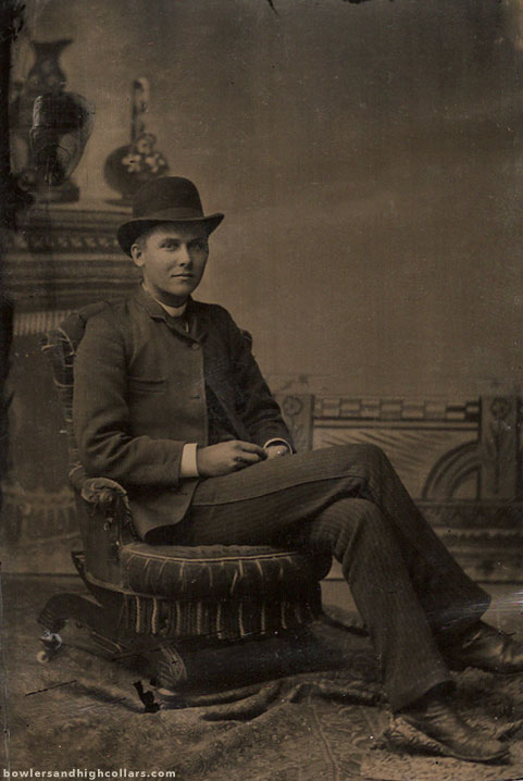 Cross legged on low chair. Tintype. Private Collection.