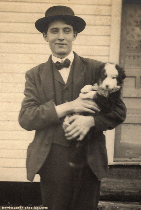 rppc-puppy-young-man-detail